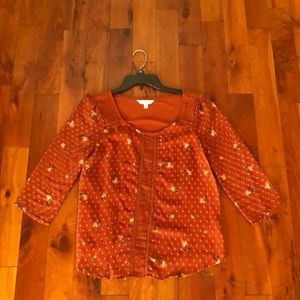 An orange blouse